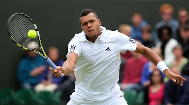 LONDON, ENGLAND - JUNE 24: Jo-Wilfried Tsonga of France plays a forehand during his Gentlemen's Singles first round match against David Goffin of Belgium on day one of the Wimbledon Lawn Tennis Championships at the All England Lawn Tennis and Croquet Club on June 24, 2013 in London, England. (Photo by Julian Finney/Getty Images)