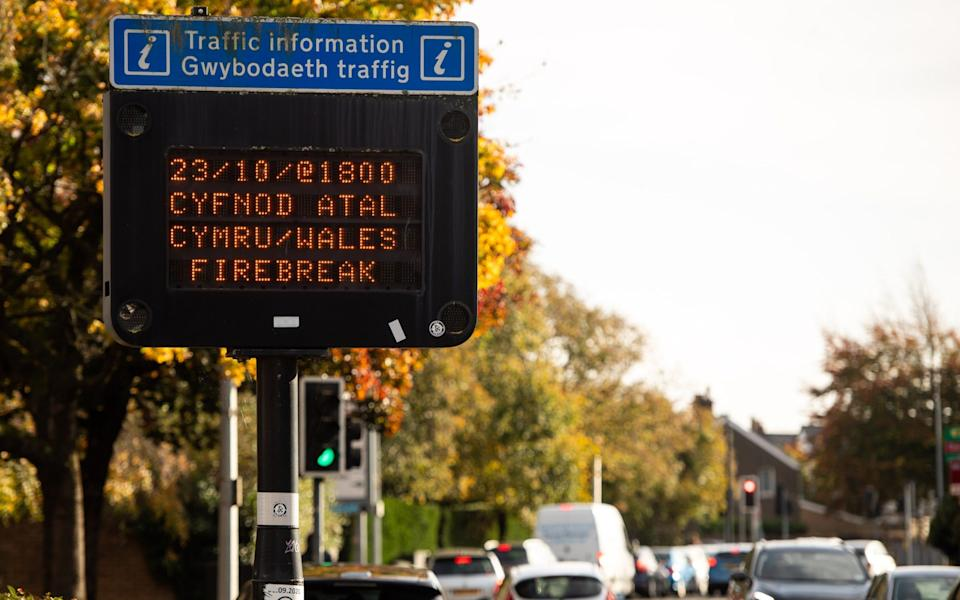 A road sign advising people that the lockdown will begin at 6pm on October 23 in Cardiff - Polly Thomas/Getty Images Europe