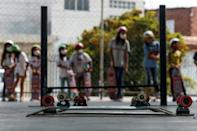 Young girls in Poa, a suburb of Sao Paulo, get ready to take their turn skateboarding (AFP/Miguel SCHINCARIOL)