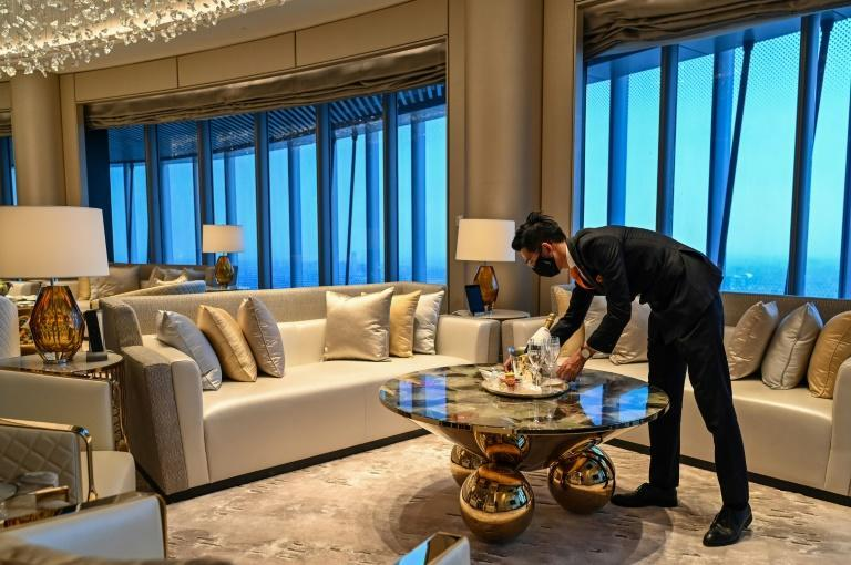 An employee is seen in a suite room of the J Hotel, the world's highest luxury hotel, in Shanghai