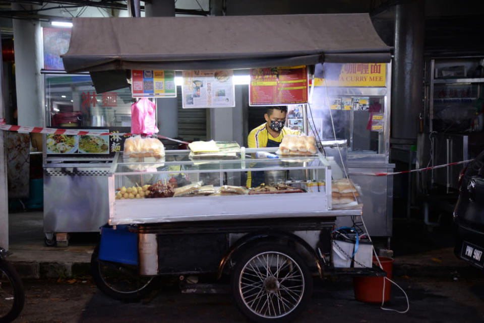 Tan Boon selling from his motorcycle hawker stall. —  Pictures by Steven Ooi KE