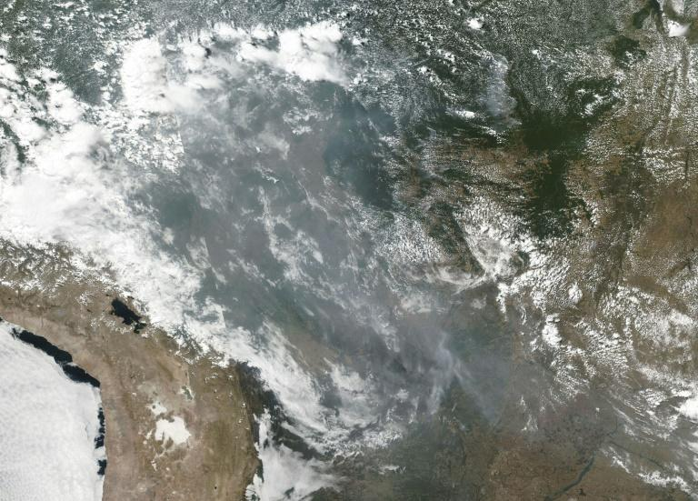 Smoke and fires can be seen across several states in Brazil in this August 22, 2019 NOAA/NASA image (AFP Photo/HO)