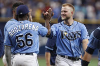 Tampa Bay Rays Austin Meadows celebrates with teammate Randy Arozarena (56) after defeating the Boston Red Sox during a baseball game Sunday, Aug. 1, 2021, in St. Petersburg, Fla. (AP Photo/Scott Audette)