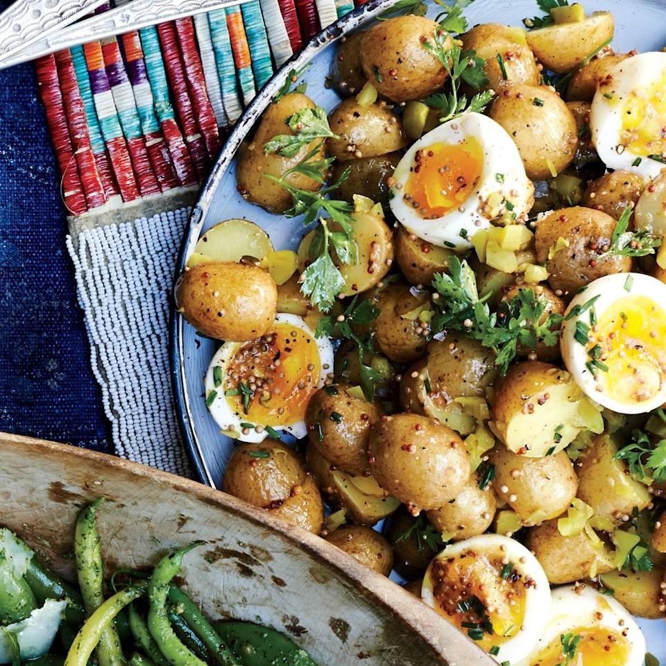 """Egg salad and potato salad: Unite! We like how the still-soft yolks dress the salad, but you can cook the eggs a minute or two longer if you like them more set. <a href=""""https://www.epicurious.com/recipes/food/views/potato-salad-with-7-minute-eggs-and-mustard-vinaigrette-56389652?mbid=synd_yahoo_rss"""" rel=""""nofollow noopener"""" target=""""_blank"""" data-ylk=""""slk:See recipe."""" class=""""link rapid-noclick-resp"""">See recipe.</a>"""