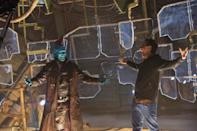 <p>The filmmaker and his star confer between takes. (Photo: Marvel) </p>