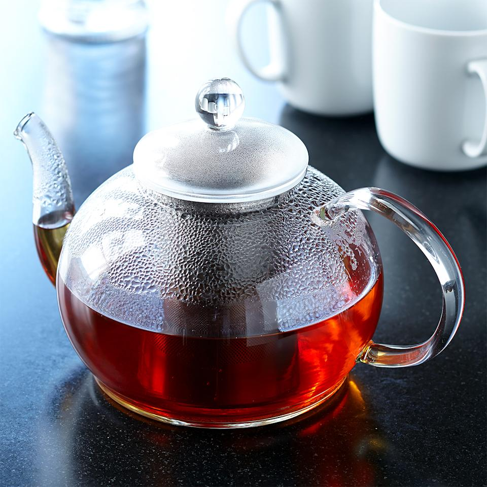 "<p>For <a href=""https://www.marthastewart.com/1055416/perfect-cup-tea"">brewing loose tea</a>, or tea bags if you like to brew more than one cup at a time or prefer to give the tea room to infuse, you'll want to get a teapot. There are endless options in ceramic, metal, or glass. Whichever material you choose, make sure the pot doesn't leak when you pour and opt for a teapot with a removable filter and a lid that can be on the pot when the filter has been removed (to keep the brewed tea warm). A glass teapot allows you to see watch the steeping process.</p><p><em>Open Kitchen by Williams Sonoma Glass Teapot</em><em>, $45,</em> <a href=""https://williams-sonoma.pdy5.net/c/249354/265127/4291?u=https%3A%2F%2Fwww.williams-sonoma.com%2Fproducts%2Fwilliams-sonoma-open-kitchen-glass-teapot%2F&amp;subid1=MMSLHOMEDeskTeaCoffeeMakersVSpencerAugust19""><em>williams-sonoma.com</em></a>.</p>"