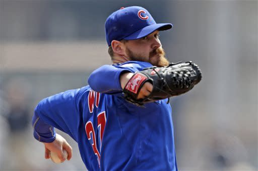 Chicago Cubs starting pitcher Travis Wood delivers during the first inning of a baseball game against the Pittsburgh Pirates in Pittsburgh, Thursday, April 4, 2013. (AP Photo/Gene J. Puskar)