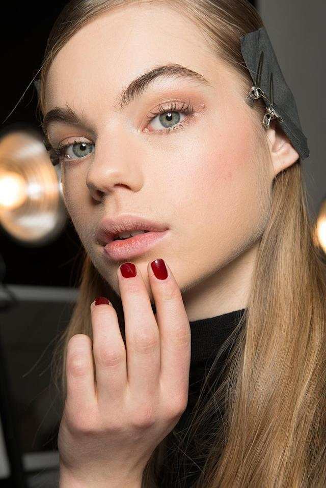 <p>According to nail tech Naomi Gonzalez for Zoya, the inspiration for the design was simple. Using a muted red to play off of the clean and uncomplicated lines of the designer creations, the choice of Zoya Courtney added a decidedly feminine power punch. (Photo: Imaxtree) </p>