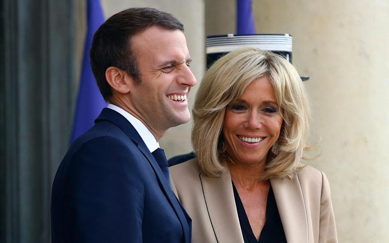 French First Lady Brigitte Macron will sit beside, not behind her husband Emmanuel at presidential visits, she has let it be known - AP