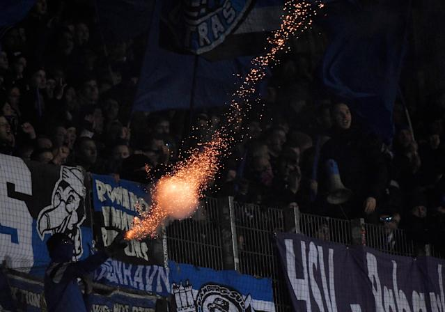 Soccer Football - Bundesliga - Werder Bremen vs Hamburger SV - Weser-Stadion, Bremen, Germany - February 24, 2018 Hamburg fans let off fireworks REUTERS/Fabian Bimmer DFL RULES TO LIMIT THE ONLINE USAGE DURING MATCH TIME TO 15 PICTURES PER GAME. IMAGE SEQUENCES TO SIMULATE VIDEO IS NOT ALLOWED AT ANY TIME. FOR FURTHER QUERIES PLEASE CONTACT DFL DIRECTLY AT + 49 69 650050