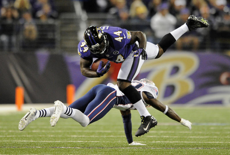 Baltimore Ravens fullback Vonta Leach, top, is upended by New England Patriots cornerback Devin McCourty as he rushes the ball in the first half of an NFL football game in Baltimore, Sunday, Sept. 23, 2012. (AP Photo/Nick Wass)