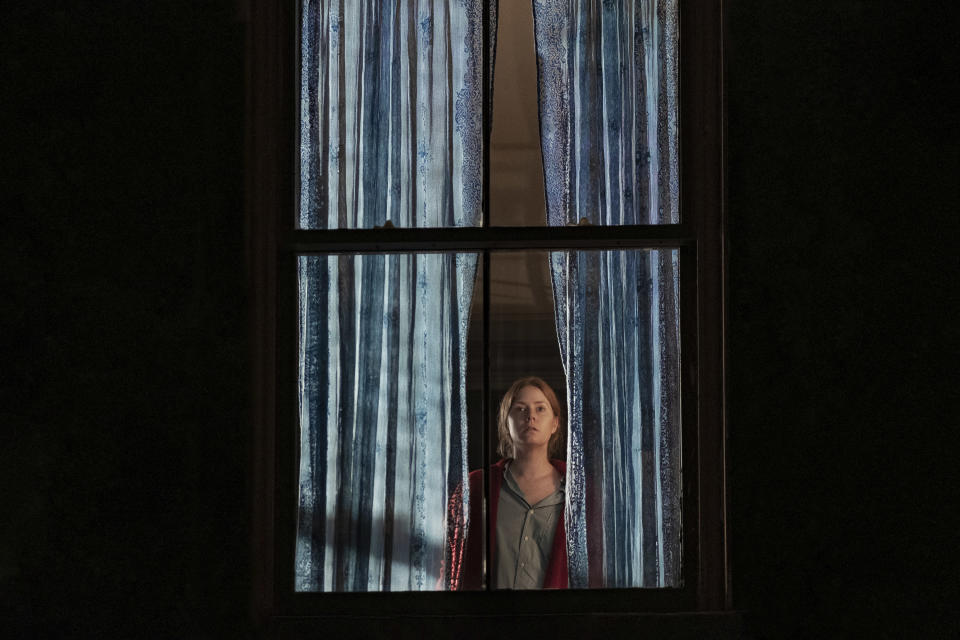 """This image released by Netflix shows Amy Adams in a scene from """"The Woman in the Window."""" (Melinda Sue Gordon/Netflix via AP)"""