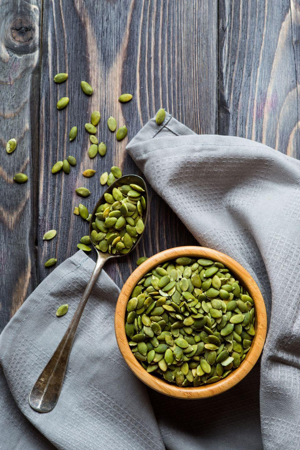"""<p>An ounce of <a href=""""https://www.goodhousekeeping.com/holidays/halloween-ideas/g2767/pumpkin-seed-recipes/"""" rel=""""nofollow noopener"""" target=""""_blank"""" data-ylk=""""slk:pumpkin seeds"""" class=""""link rapid-noclick-resp"""">pumpkin seeds</a> provides nearly 20% of your daily value of magnesium, plus potassium. Sprinkle these seeds (and nuts, like walnuts, peanuts, pistachios, and cashews) on your meals or snack on 'em plain for a nutrient boost. <br></p>"""