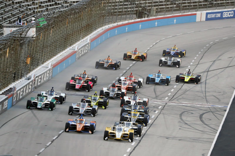 The field gets a green flag for the start of an IndyCar auto race at Texas Motor Speedway in Fort Worth, Texas, Saturday, June 6, 2020. (AP Photo/Tony Gutierrez)
