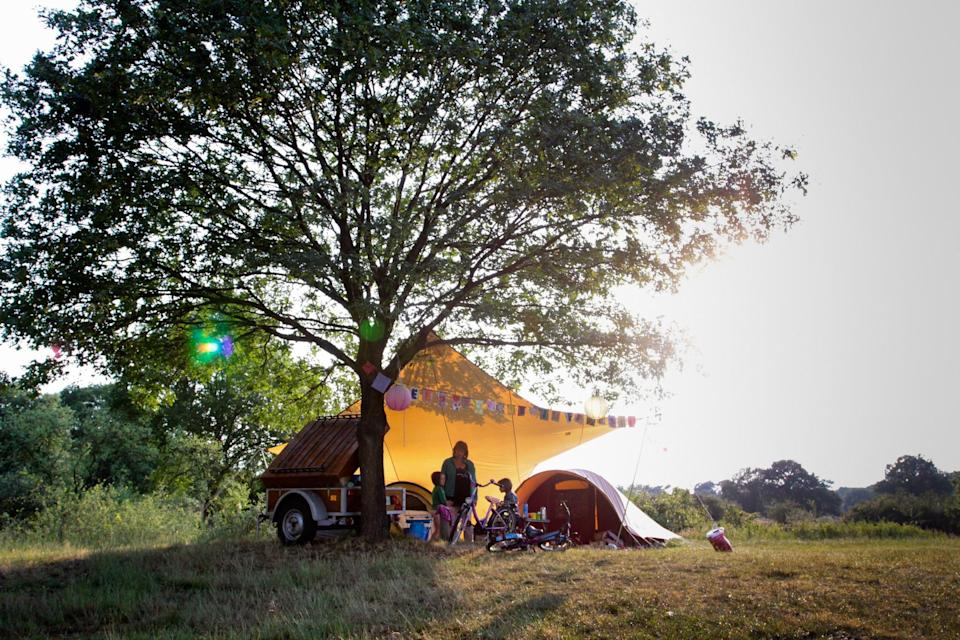 """<p><span>Sitting on the banks of the River Vecht, </span><a href=""""https://coolcamping.com/campsites/europe/netherlands/central-netherlands/overijssel/640-camping-de-roos"""" rel=""""nofollow noopener"""" target=""""_blank"""" data-ylk=""""slk:this laid-back, car-free, family campsite"""" class=""""link rapid-noclick-resp""""><span>this laid-back, car-free, family campsite </span></a><span>is a haven for children with room to roam. There's also beach and small pier for river swimming, as well as bikes for hire. A tent and two people from €17.50 (£15). [Photo: Cool Camping]</span> </p>"""