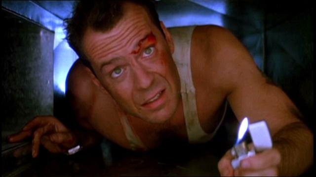 """'Die Hard' – Sunny Los Angeles, gunfire, East German terrorists, explosions, and John McClane's bloody, glass-filled feet? While John McTiernan's action classic """"Die Hard"""" may not seem like holiday movie fodder on the surface, some would argue that it's the best """"Dad saves Christmas"""" movie ever made. Set on Christmas Eve, New York cop John McClane (Bruce Willis) must save his estranged wife and her coworkers from a group of heavily armed hostage takers led by Hans Gruber (Alan Rickman). How can you deny that """"Die Hard"""" is a holiday classic when one of its most memorable lines is """"HO, HO, HO! Now I have a machine gun!""""?"""