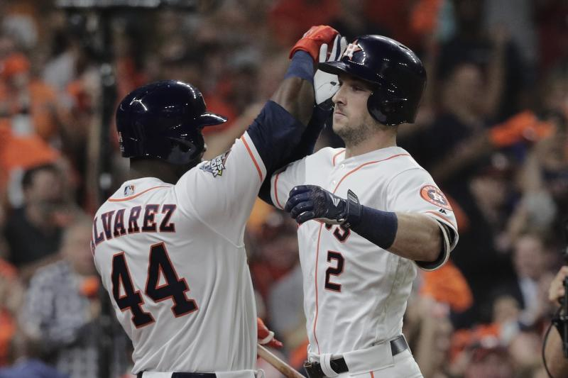 Houston Astros' Alex Bregman is congratulated by Yordan Alvarez after hitting a home run during the first inning of Game 6 of the baseball World Series against the Washington Nationals Tuesday, Oct. 29, 2019, in Houston. (AP Photo/David J. Phillip)