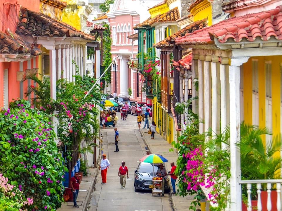 Street in walled city in Cartagena Colombia with people walking