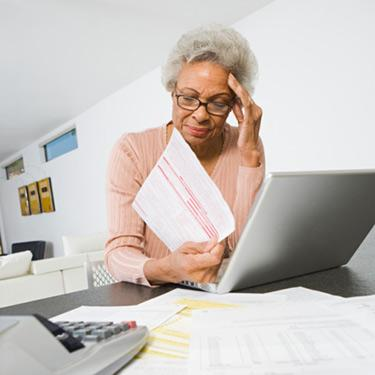 Senior-woman-worrying-about-home-finances_web