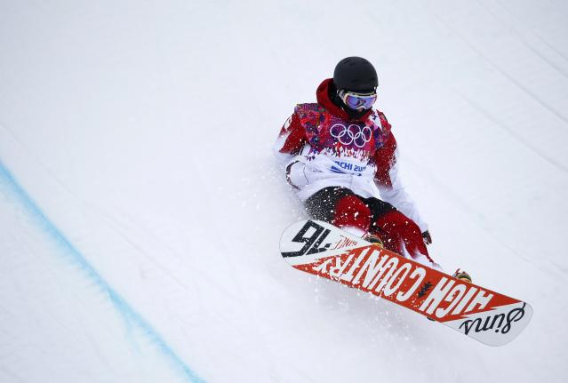 Canada's Derek Livingston crashes during the men's snowboard halfpipe qualification round at the 2014 Sochi Winter Olympic Games in Rosa Khutor