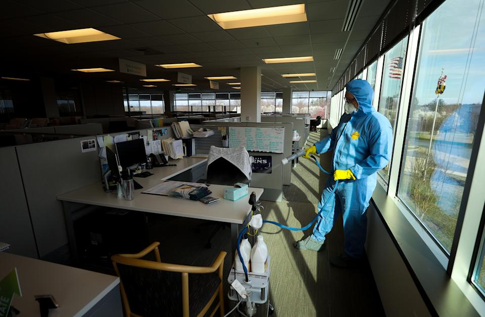 HUNT VALLEY, MARYLAND - MARCH 21: Maryland Cleaning and Abatement Services employee Conner Reed preforms a preventative fogging and damp wipe treatment at an office building on March 21, 2020 in Hunt Valley, Maryland. The outbreak of the COVID-19 pandemic has sparked more proactive measures at businesses to combat the spread of the coronavirus. (Photo by Rob Carr/Getty Images)
