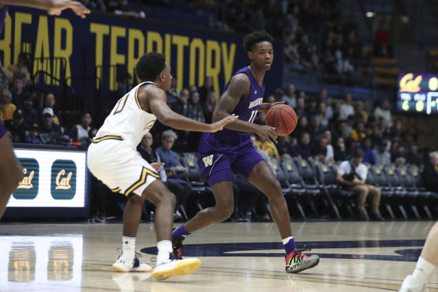 Washington guard Nahziah Carter (11) drives against California guard Kareem South (10) during the first half of an NCAA college basketball game in Berkeley, Calif., Saturday, Jan. 11, 2020. (AP Photo/Jed Jacobsohn)