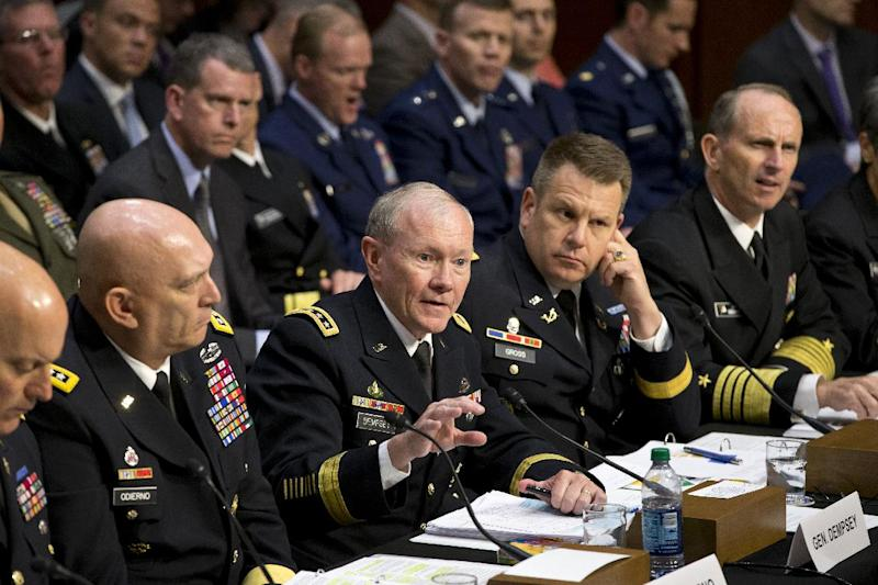 FILE - In this June 4, 2013 file photo, Joint Chiefs Chairman Gen. Martin Dempsey, center, testifies on Capitol Hill in Washington, before the Senate Armed Services Committee hearing investigating the growing epidemic of sexual assaults within the military. The number of reported sexual assaults across the military shot up by more than 50 percent this year. Defense officials suggest that victims are becoming more willing to come forward. The increase follows a tumultuous year of scandals that shined a spotlight on the crimes and put pressure on the military to act aggressively. From left are, Judge Advocate General of the Army Lt. Gen. Dana K. Chipman, Army Chief of Staff Gen. Ray Odierno, Legal Counsel to the Chairman of the Joint Chiefs of Staff Brig. Gen. Richard C. Gross, and Chief of Naval Operations Adm. Jonathan W. Greenert.(AP Photo/J. Scott Applewhite)