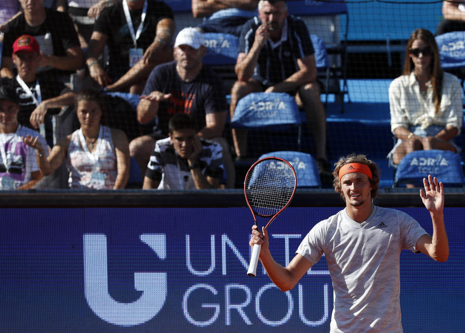 Germany's Alexander Zverev reacts during the match against Serbia's Novak Djokovic, of the Adria Tour charity tournament in Belgrade, Serbia, Sunday, June 14, 2020. (AP Photo/Darko Vojinovic)