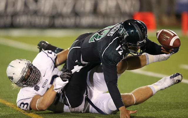 Nevada's Brock Hekking (53) forces Hawaii's Jeremy Higgins (12) to fumble, during the second half of an NCAA college football game in Reno, Nev., on Saturday, Sept. 21, 2013. Nevada recovered the fumble. (AP Photo/Cathleen Allison)