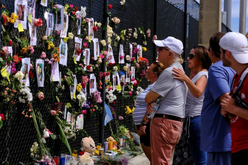 A memorial site created by neighbors in front of Champlain Towers South, in Surfside