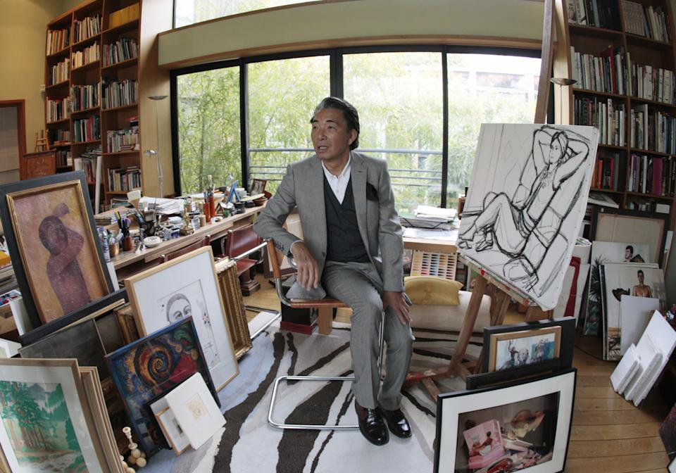 """Paris-based Japanese designer Kenzo Takada, aka """"Kenzo"""", poses in the workshop on March 24, 2009 of his 1.362 m2 loft in Paris, during a press presentation of his collection of art works, furnitures which will be auctionned on June 16 and 17, 2009 at Drouot Montaigne auction house. AFP PHOTO FRANCOIS GUILLOT (Photo credit should read FRANCOIS GUILLOT/AFP via Getty Images)"""