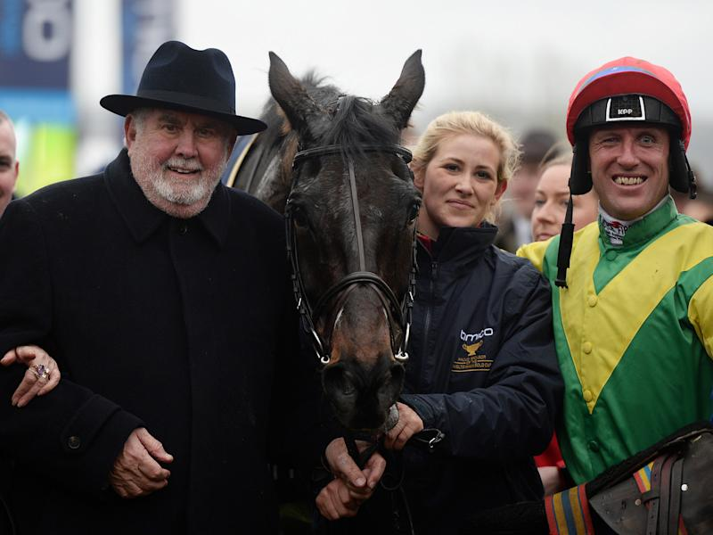 Alan Potts, left, poses with his victorious horse Sizing John and jockey Robbie Power: Getty