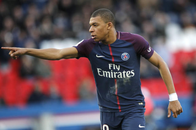 PSG's Kylian Mbappe celebrates his side's second goal during the French League One soccer match between Paris Saint-Germain and Angers at the Parc des Princes Stadium, in Paris, France, Wednesday, March 14, 2018. (AP Photo/Christophe Ena)