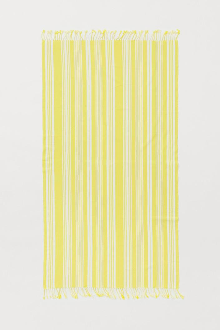<p>Take this <span>Fringed Beach Towel</span> ($25) on your next surf day.</p>