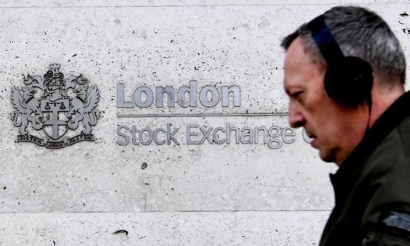 A pedestrian passes the London Stock Exchange