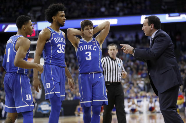 Duke head coach Mike Krzyzewski, right, talks with Grayson Allen (3), Marvin Bagley III (35) and Trevon Duval (1) during the second half of a regional final game against Kansas in the NCAA men's college basketball tournament Sunday, March 25, 2018, in Omaha, Neb. (AP Photo/Nati Harnik)