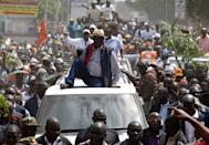 <p>Kenyan opposition leader Raila Odinga of the National Super Alliance (NASA) coalition is welcomed by his supporters upon his return in Nairobi, Kenya, Nov. 17, 2017. (Photo: Baz Ratner/Reuters) </p>