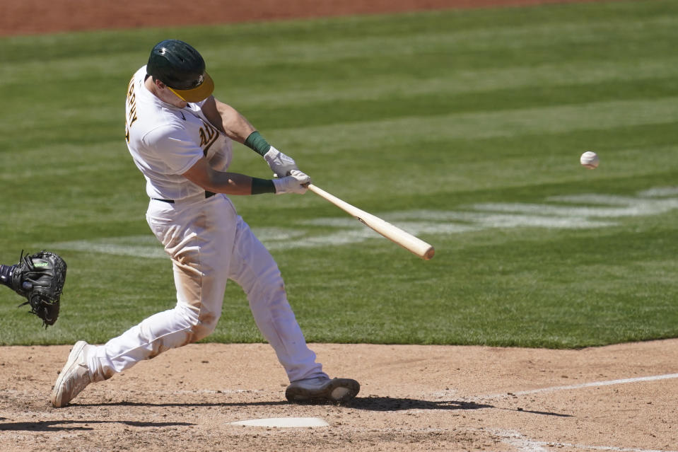 Oakland Athletics' Sean Murphy hits a solo home run against the Detroit Tigers during the eighth inning of a baseball game in Oakland, Calif., Sunday, April 18, 2021. (AP Photo/Jeff Chiu)