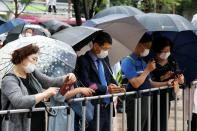 Supporters of late Seoul Mayor Park Won-soon gather outside Seoul City Hall Plaza, where his funeral is being held, in Seoul