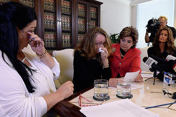LOS ANGELES, CA - SEPTEMBER 30: Lisa Christie, (C) former Mrs. America, 1997-1998, reacts as Pamela Abeyta, (L) and Sharon Van Ert (R), three new alleged sexual assault victims of comedian Bill Cosby, speak during a news conference with attorney Gloria Allred September 30, 2015, in Los Angeles, California. Cosby has been accused of sexual assault by over 30 women. (Photo by Kevork Djansezian/Getty Images)