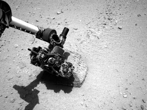 "NASA's Curiosity rover performs ""contact science"" operations on a rock called ""Jake Matijevic"" in this photo, which was snapped Sept. 22, 2012."