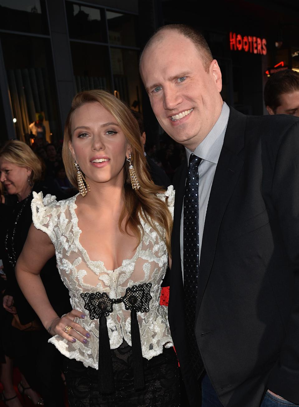 """HOLLYWOOD, CA - MARCH 13:  Actress Scarlett Johansson and  President of Production at Marvel Studios Kevin Feige attend the premiere of Marvel's """"Captain America: The Winter Soldier"""" at the El Capitan Theatre on March 13, 2014 in Hollywood, California.  (Photo by Kevin Winter/Getty Images)"""