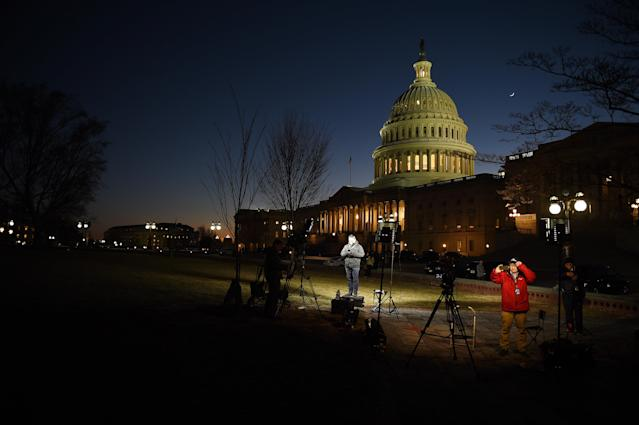 <p>TV crews set up their lights for a long night reporting on politics on Capitol Hill in Washington, Jan. 19, 2018, where lawmakers struggle to avoid an impending government shutdown. (Photo: Astrid Riecken for The Washington Post via Getty Images) </p>