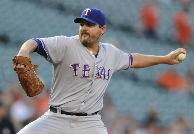 Texas Rangers starting pitcher Joe Saunders throws against the Baltimore Orioles in the first inning of a baseball game, Monday, June 30, 2014, in Baltimore. (AP Photo/Gail Burton)