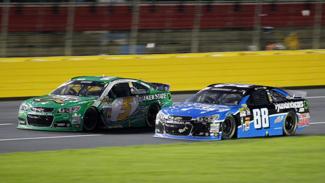 Kasey Kahne (5) and Dale Earnhardt Jr. (88) race on the front stretch during the NASCAR Sprint Cup Series auto race at Charlotte Motor Speedway in Concord, N.C., Saturday, Oct. 12, 2013. (AP Photo/Terry Renna)