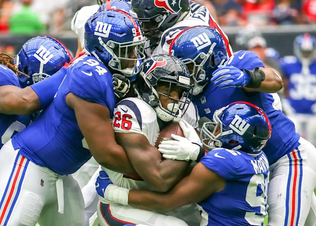 <p>Houston Texans Running Back Lamar Miller (26) gets tackled by New York Giants Defensive Tackle Dalvin Tomlinson (94) and New York Giants Linebacker Kareem Martin (96) during the football game between the New York Giants and Houston Texans on September 23, 2018 at NRG Stadium in Houston, Texas. (Photo by Leslie Plaza Johnson/Icon Sportswire via Getty Images) </p>