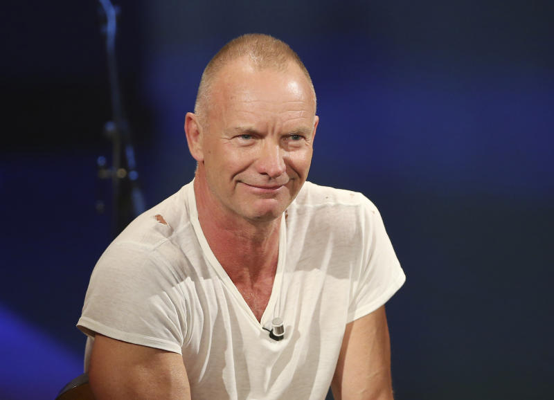 """FILE - In this Nov. 10, 2013 file photo, British singer Sting smiles during the Italian State RAI TV program """"Che Tempo che Fa"""", in Milan, Italy. Sting and Paul Simon are rehearsing for their upcoming tour, a couple of longtime friends and neighbors preparing to take turns singing some of each other's biggest hits. """"He's the master,"""" Sting said Monday, Jan. 20, 2014, by satellite from New York. """"If I ever wanted to emulate a literary and literate songwriter, then Paul Simon would be the person I would go to."""" (AP Photo/Antonio Calanni, file)"""