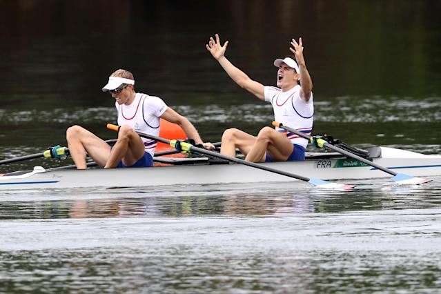 <p>Pierre Houin (R) and Jeremie Azou (L) of France celebrate winning the gold medal after the Lightweight Men's Double Sculls Final A on Day 7 of the Rio 2016 Olympic Games at Lagoa Stadium on August 12, 2016 in Rio de Janeiro, Brazil. (Getty) </p>