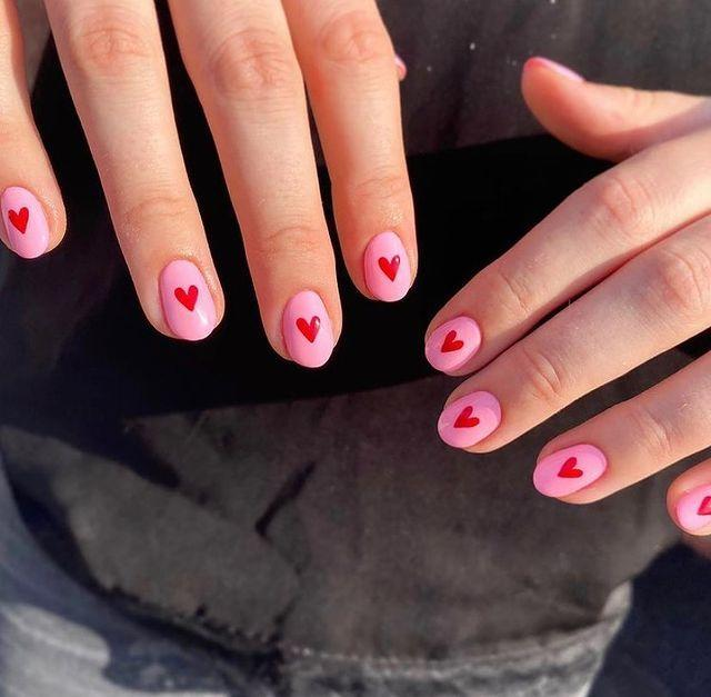 """<p>There's something so classic and chic about the pairing of red and pink and the addition of a heart traced right in the center of the nail.</p><p><a href=""""https://www.instagram.com/p/CKT6EDiHlnV/"""" rel=""""nofollow noopener"""" target=""""_blank"""" data-ylk=""""slk:See the original post on Instagram"""" class=""""link rapid-noclick-resp"""">See the original post on Instagram</a></p>"""