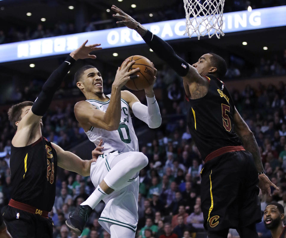 Celtics forward Jayson Tatum drives to the basket against the Cavaliers during the second quarter Wednesday night. (AP)
